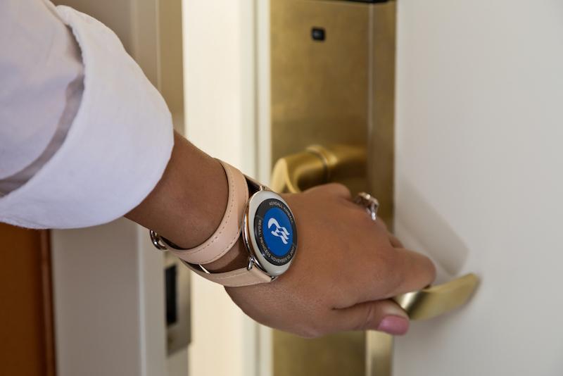 Ocean Medallion Close-up - Guest Opening Stateroom Door